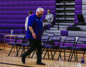 Head coach Ed Fritz walks off the court after being defeated by the Lawrence Lions in the state quarterfinal game. The game would end up being his last time coaching the Huskies.