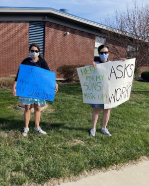 BVNW parent Julie Passatt stands with retired teacher Colleen Knight as they protest outside of District Office.