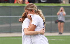 Junior Megan Yates (left) consoles senior Isabel Schelhammer (right) after the Huskies loss in the state quarterfinals.