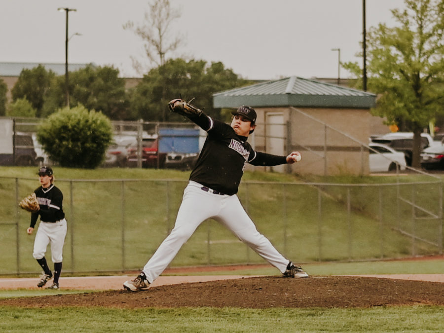 Sophomore Easton Wasinger (24) throws a pitch in the varsity baseball game.