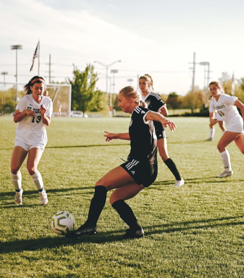 Senior Mary Hungerford kicks the ball in a game against St. Teresas Academy, April 29.