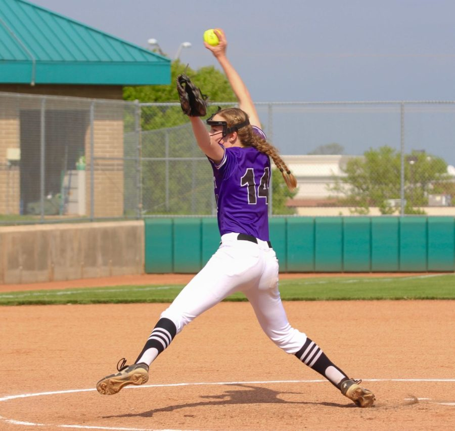 Freshman Elise Grosdidier throws a pitch in the varsity softball game against Mill Vallley.