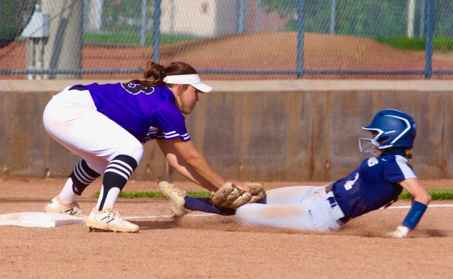 Senior Olivia Shin tags a runner in the varsity softball game against Mill Valley.