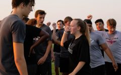 Freshman Caitlyn Kingler breaks the huddle with her teammates during a football practice.