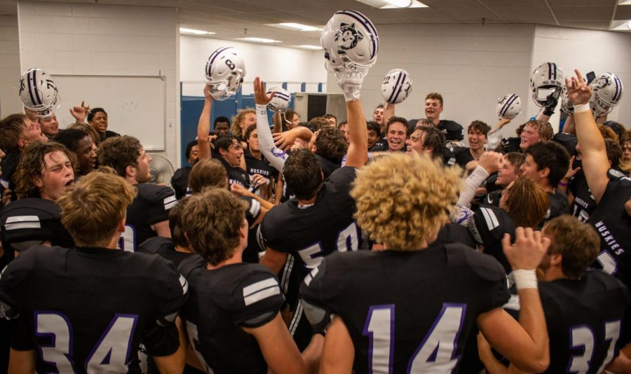 The varsity football team celebrates a 35-21 win over Blue Valley in their season-opener.