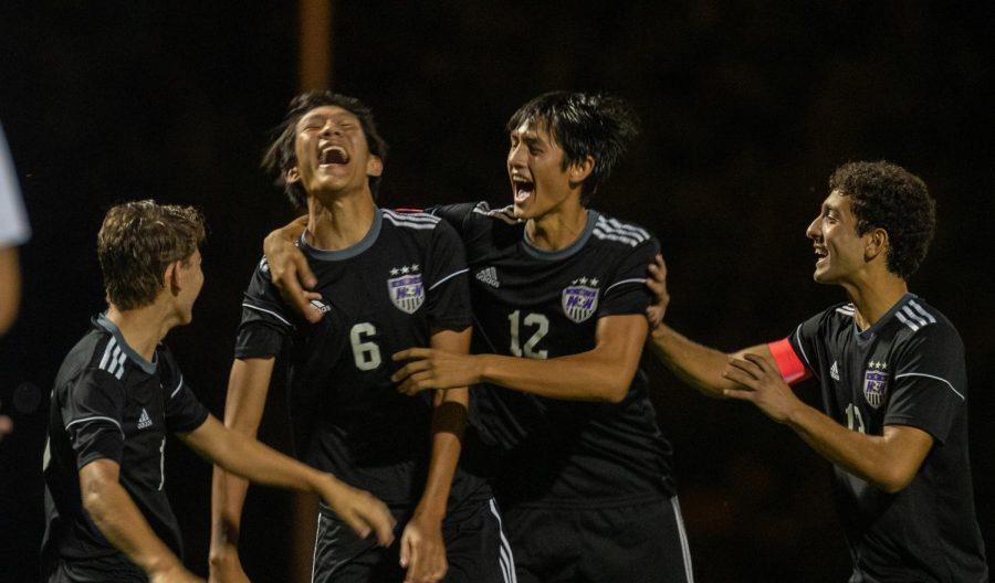 Junior Ricki Li (6) celebrates with his teammates after scoring a goal against Bishop Miege.