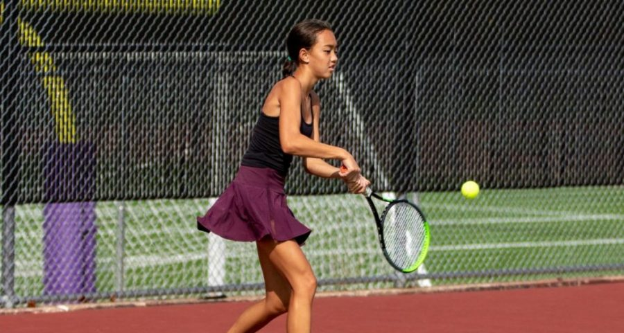 Junior Emily Chiasson returns the ball in a tennis match, Sept. 20.
