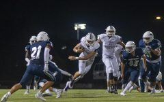 Senior Mikey Pauley evades defenders in the Huskies victory over North, Oct. 8.